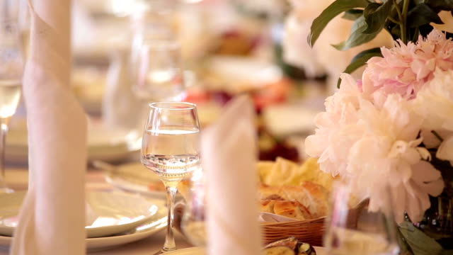 The elegant wedding or birthday dinner table with flowers, close up video