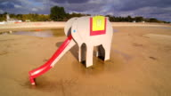 The elephant slide on the shore video