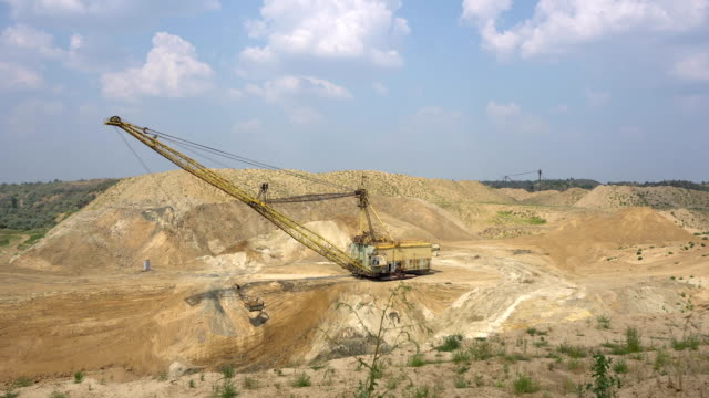 The excavator works in a quarry video