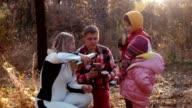 The family has tea in autumn park video