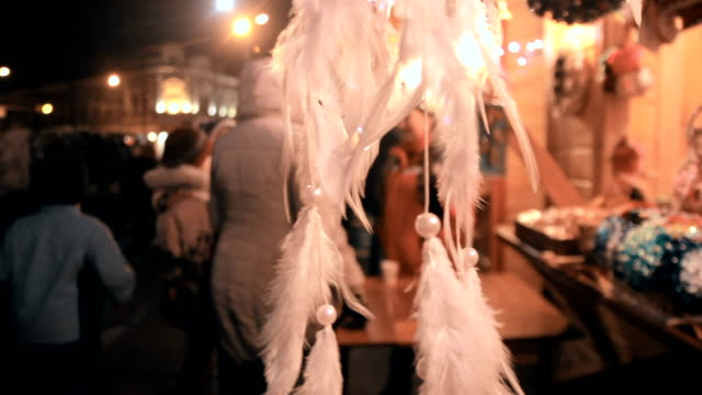 The feathers accessory hanging on the display video