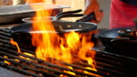 The fish in the pan is grilled video