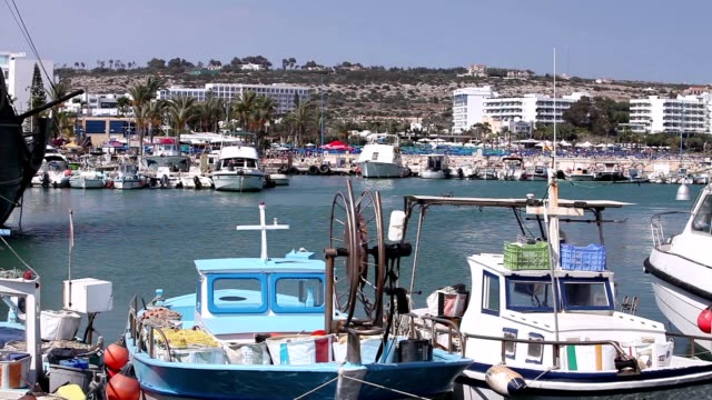The fishing boats standing at the pier, fishing boats parking, Group of fisherman boat mooring at jetty on video