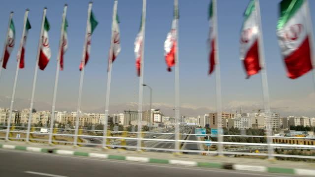 The flag of Iran waving in Tehran video