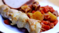The food in the restaurant, potatoes with vegetables and shashlik video