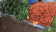 The fruit vendors in the Indian market put their wares on the ground video