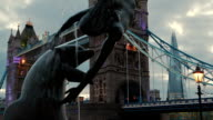 The Girl and Dolphin Statue with the Tower Bridge and The Shard, London, England, UK video