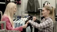 The girl chooses a dress in shop video