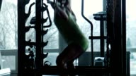 The girl does exercises in a gym video