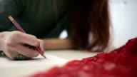 The girl draws pencil sketch on paper. Close-up. video