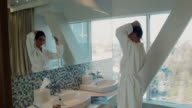 The girl in hotel near a mirror video
