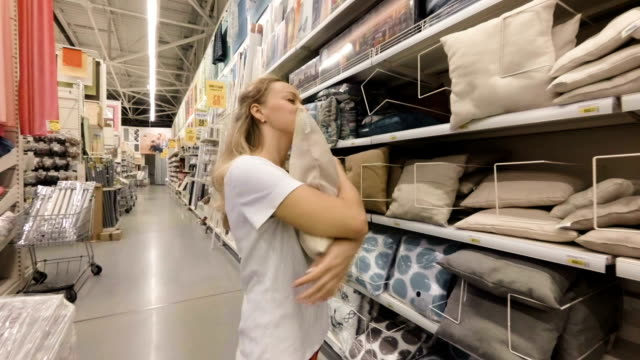 The girl is happy because she found the pillow. Slow motion video