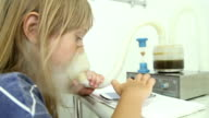 The girl is treated, making inhalation, uses the inhaler video
