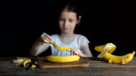The girl makes the ship bananas and plays with it. video