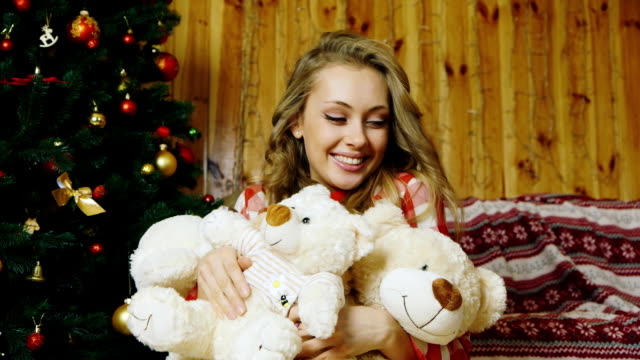 The girl presses to a lot of toy bears video