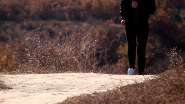 The girl running in autumn park. video