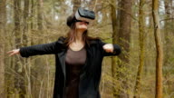 The girl see the world with virtual reality glasses video