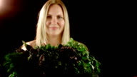 The girl shows herbs in the camera video