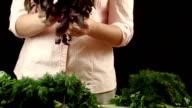 The girl sorts herbs video