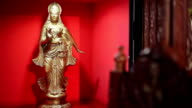 The golden indian statuette in the restaurant video