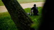 The Guy Is Resting In Forest With A Bike video