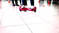 The guy shows to ride Hoverboard video