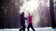 The guy with the girl throw up snow upwards video
