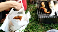 The hands are grilled Seafood grill or  barbecue with charcoal in the party. video