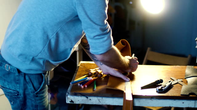 The hands of 20s 30s craftsman is measuring ruler master skin in his workshop video