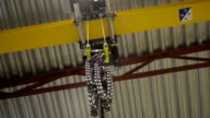 The hanging chains inside the factory video