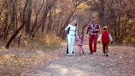 The happy family walks in autumn park video