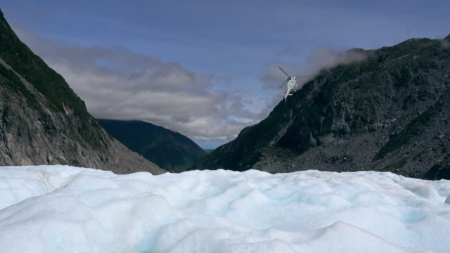 The helicopter carries the visitor through Fox glaciers Southern island, New Zealand video