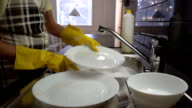 The housewife washes the dishes in the kitchen. Slow Motion. Dolly shot. video
