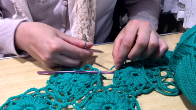 The individual entrepreneur is engaged in knitting clothes and accessories. video