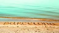 The inscription Barcelona on sand. video