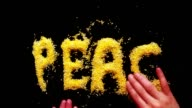 the inscription PEACE made by man's hands on the table of the yellow cornmeal retro, vintage video