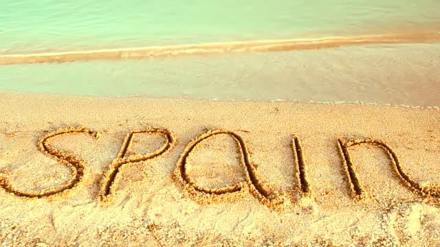The inscription Spain on sand. video
