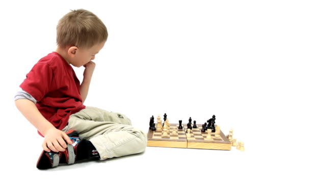 The joy of a boy playing chess. Little genius. video
