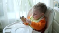The little boy is eating ice cream video