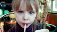 The little girl drinks cocktail and licks sauce video