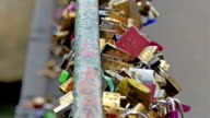 The lovelocks locked on the bridge in Paris video