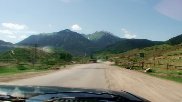 The Machine moves forward on a bad country road. The view through the windshield video