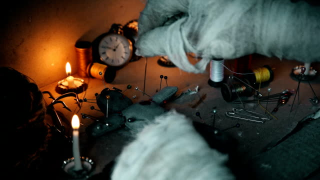 the mage conducts a ritual with a voodoo doll and sticks pins in it video