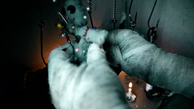 the magician hangs a voodoo doll on the hook video