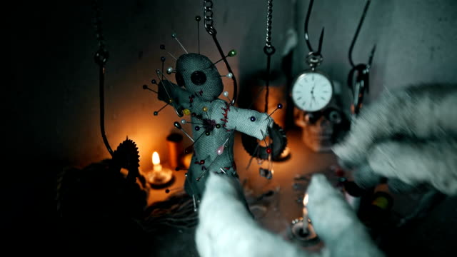 the magician removes the voodoo doll off the hook video