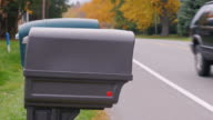 The mailbox near the road. Typical landscape in the US video
