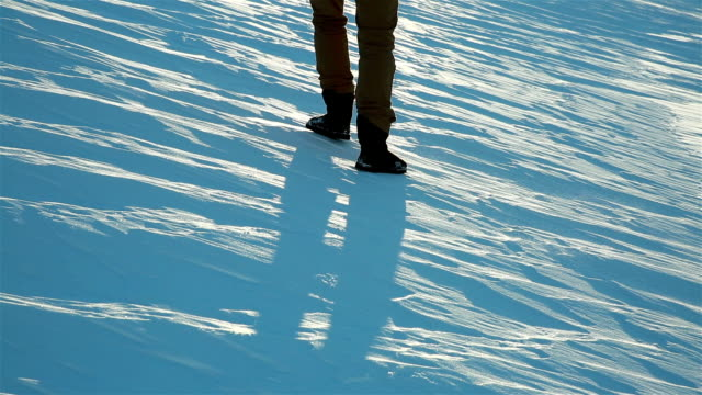 The man cautiously goes on the slippery ice crust in winter. video