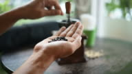 The man checked a coffee beans and put it in the coffee grinder. video