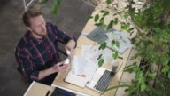 The man in the workplace drinking vitamins and drinks water video