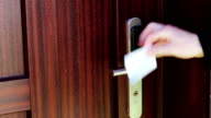 The man opens the door to an electronic key - card video